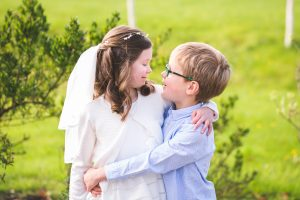 first holy communion, candid portrait, communion day, kildare communion photographer siblings portrait